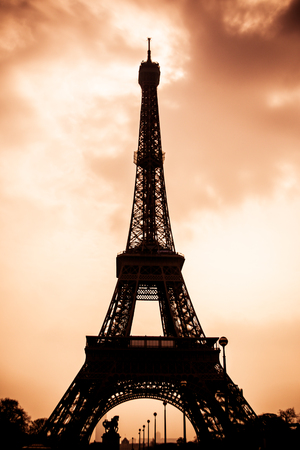 The Eiffel Tower of France shot in silhouette and sepia. Stock Photo