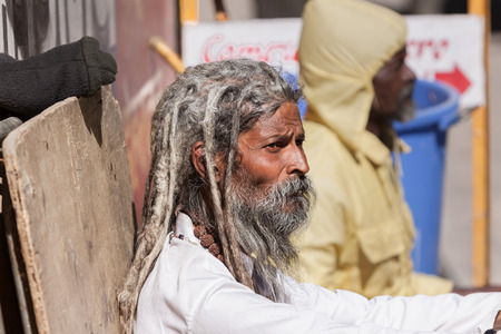 vedas: GANGOTRI, INDIA - MAY 23rd - An old sadhu sits outside the temple of Goddess Ganga at Gangotri on May 23rd 2013. Editorial