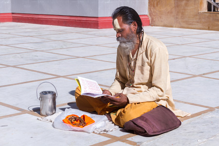 scriptures: Gangotri, Uttarakhand - CIRCA May 2013 - A Hindu priest sits in the temple courtyard to read Vedic scriptures in Gangotri circa May 2013. Editorial