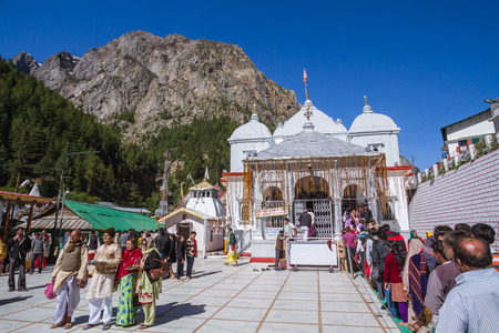dome of hindu temple: Gangotri, Uttarakhand - CIRCA May 2013 - Hindu pilgrims stand in line to enter the temple in Gangotri circa May 2013.