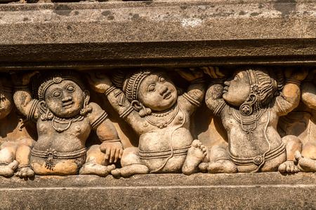 Carving of dwarf-like Yakshas at the Kelaniya temple in Sri Lanka.