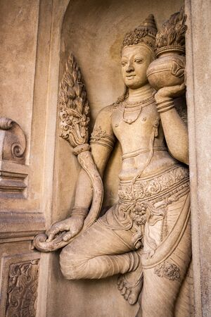 doorkeeper: A carving of a doorkeeper at the Kelaniya temple in Sri Lanka. Stock Photo