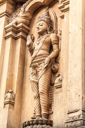A carving of Vihsnu at the Kelaniya temple in Sri Lanka. Stock Photo