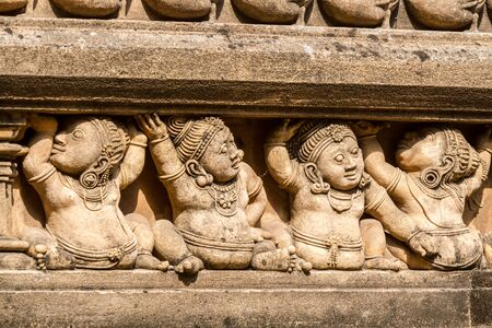 sri lanka temple: Carving of dwarf-like Yakshas at the Kelaniya temple in Sri Lanka.
