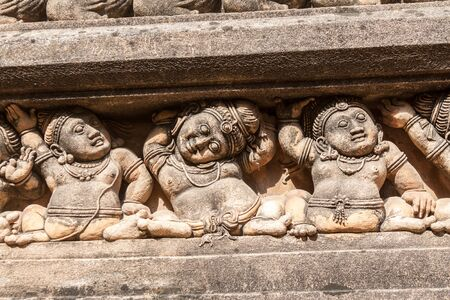 Carving of dwarf-like Yakshas at the Kelaniya temple in Sri Lanka.
