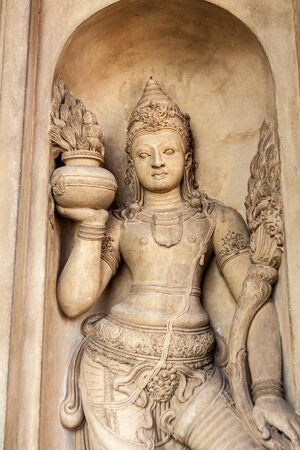 A Carving of a temple doorkeeper in Kelaniya, Sri Lanka 스톡 콘텐츠