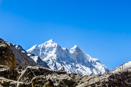 The Bhagirati Peaks in the Indian Himalayas as visible from the Ganges Glacier valley. Stock Photo