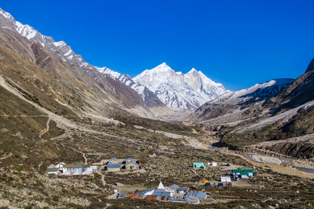 The settlement of Bhojbas in the Indian Himalayas with the Bhagirati peaks in the background.