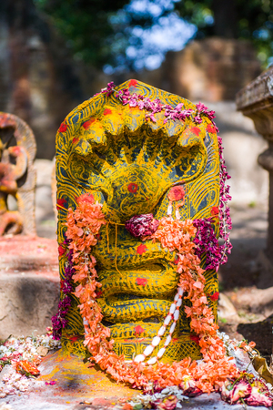 A stone carving of a naga (snake god) in the south of India. Stock Photo