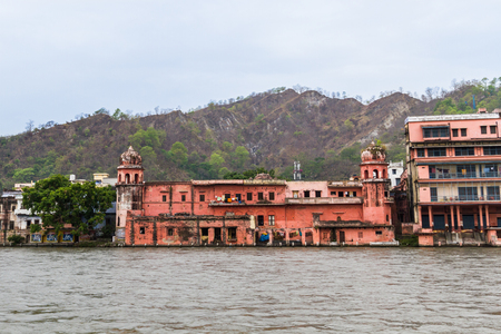 Old Ashram buildings on the banks of the ganges river in Haridwar, India