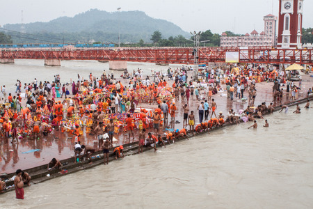 worshipping: HARIDWAR, INDIA - MAY 12 - Hindu Pilgrims gather on the banks of the holy river in prepartion for Ganga Artik on May 12th 2013 at Haridwar, India. Editorial