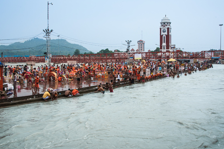 pooja: HARIDWAR, INDIA - AUGUST 10 - Hindu Pilgrims gather on the banks of the holy river in prepartion for Ganga Artik on August 10th 2010 at Haridwar, India.