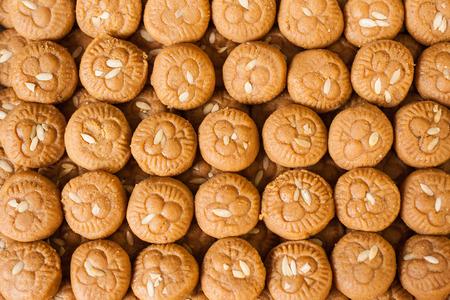 Stacks of Indian milk sweets in a shop (Peda). Standard-Bild