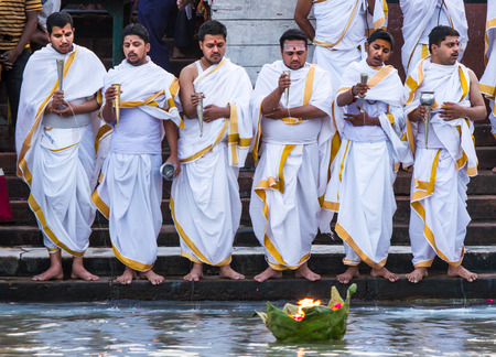 pooja: HARIDWAR, INDIA - MAY 12 - Hindu Priests make an offering of milk into the sacred Ganges river on May 12th 2013 at Haridwar, India. Editorial