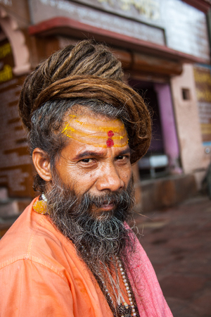mendicant: HARIDWAR, INDIA - AUGUST 10 - A Hindu Saint attends the Ardha-mela on August 10th 2010 at Haridwar, India.