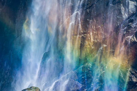 joga: A rainbow shining in of the mist of a waterfall in south India - Jog Falls.