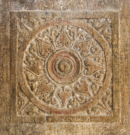 chakra: A chakra carved into a ancient temple wall. Stock Photo