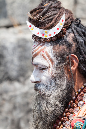 KEDARNATH, INDIA - JUNE 1 - 2013 - A naga sadhu at the shrine of Kedarnath in North India.