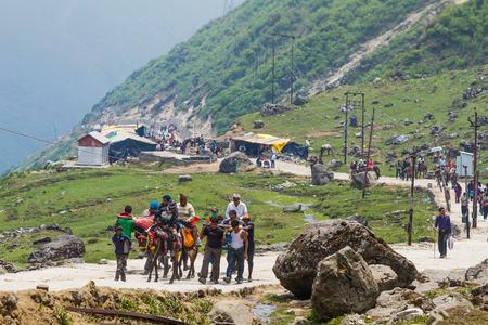 devotee: KEDARNATH, INDIA - JUN 1st 2013 - Pilgrims travel the long road to the Temple of Shiva in the Kedarnath Valley.