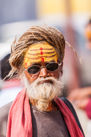 sadhu: ALLAHABAD, INDIA - FEB 14th - An old sadhu with dreadlocks wearing yellow sandalwood lines denoting him as a follower of the Hindu god Shiva at  the Kumbha Mela on February 14th 2013 Editorial