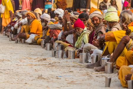 ALLAHABAD, INDIA - FEB 14 - Hindu Sadhus wait for free food distribution during the festival of Kumbha Mela on February 14th 2013 at Allahabad, India.
