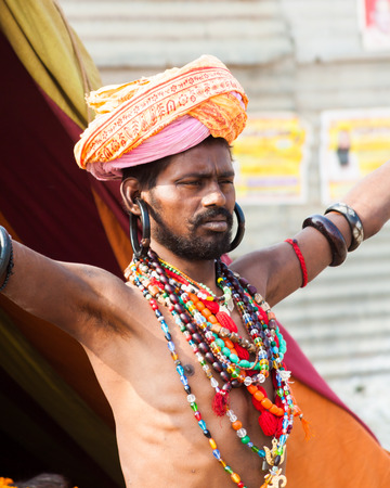 ALLAHABAD, INDIA - FEB 13 - An elaborately dressed holy man performing standing meditation at the festival of Kumbha Mela on February 13th 2013 at Allahabad, India. Editorial