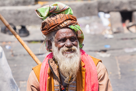 sadhu: KEDARNATH, INDIA - JUNE 1 - 2013 - A naga sadhu at the shrine of Kedarnath in North India.
