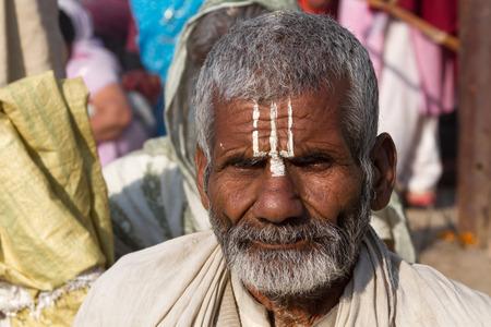 devotee: Allahabad, India- CIRCA Jan 2013 - A Hindu pilgrim on the banks of the Ganges River at Kumbha Mela circa Jan 2013.