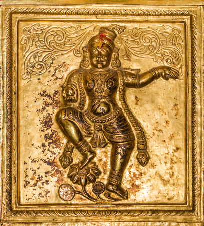 karnataka culture: A brass relief of the Hindu god, Krishna, dancing