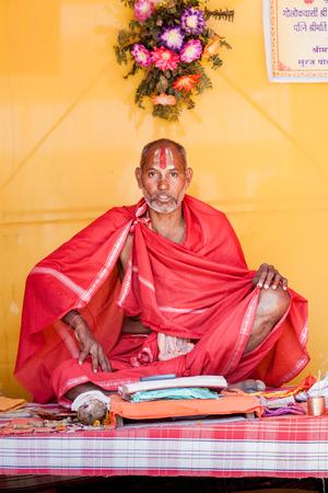 sectarian: ALLAHABAD, INDIA - FEB 14th - A brahmin priest of the Vaishnava Ramanandi sect at  the Kumbha Mela on February 14th 2013