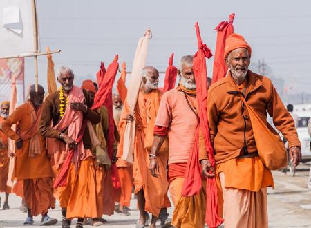 sectarian: ALLAHABAD, INDIA - FEB 13th - A group of sannyasis (monks) of the Shankara Order walking at  the Kumbha Mela on February 13th 2013 Editorial