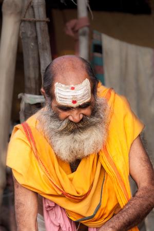 sectarian: ALLAHABAD, INDIA - FEB 14th - A brahmin priest sporting white horizontal lines on his forehead denoting him as a follower of the Hindu god Shiva at  the Kumbha Mela on February 14th 2013