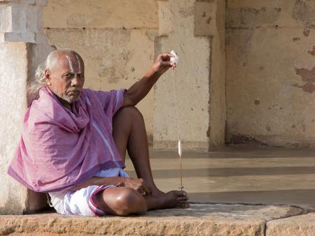 MELKOTE, INDIA - DECEMBER 11th - A brahmin priest makes new thread on December 11th 2007 at Melkote, India.