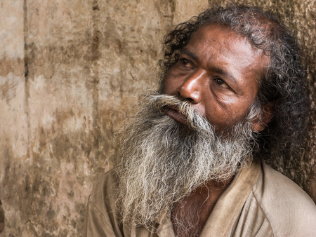 mendicant: An old man begging. Editorial