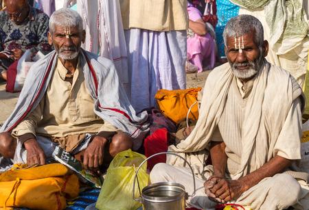 Allahabad, India- CIRCA Jan 2013 -Two old Hindu pilgrims on the banks of the Ganges River at Kumbha Mela circa Jan 2013. Editorial