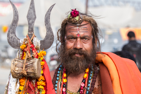 Allahabad, India- CIRCA Jan 2013 - A Hindu sadhu holding a holy trident at the Kumbha Mela in Allahabad, India, circa Jan 2013.