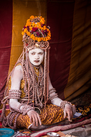 ALLAHABAD, INDIA - FEB 13 - An elaborately dressed holy man sits in his tent during the festival of Kumbha Mela on February 13th 2013 at Allahabad, India. Editorial