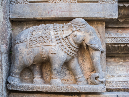 stone wall: A stone elephant carved into a temple wall.