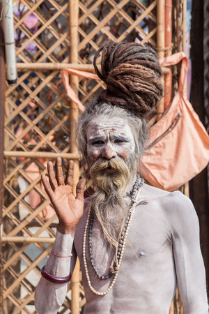 devotee: ALLAHABAD, INDIA - FEB 13 - A Hindu holy man gives a blessing during the festival of Kumbha Mela on February 13th 2013 at Allahabad, India.