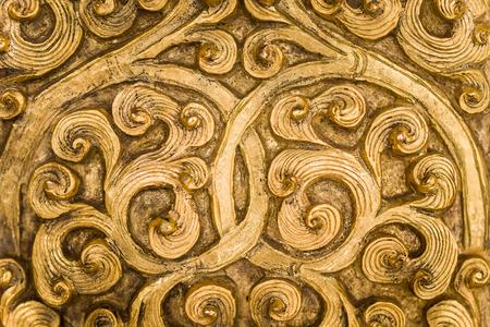Intricate goldwork on a door.