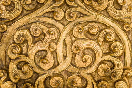 filagree: Intricate goldwork on a door.