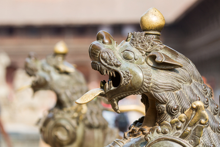 A close up of a brass lion outside a Hindu temple in Bhaktapur, Nepal
