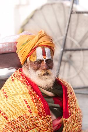 sectarian: VARANASI, INDIA - FEB 18 - A Hindu priest in Varanasi wearing sectarian markings on his face.