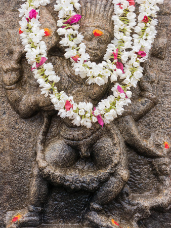 vedas: A god carved on a stone pillar at the the temple of Shiva in Nanjangud, South India.