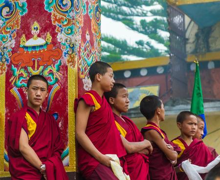reciting: SWAYAMBHUNATH, NEPAL - MAY 3: Tibetan monks wait stand in line during a Buddhist ritual.
