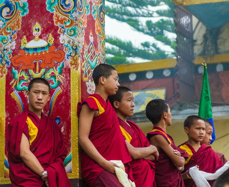 nepali: SWAYAMBHUNATH, NEPAL - MAY 3: Tibetan monks wait stand in line during a Buddhist ritual.