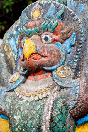 A painted statue of Garuda, the half-man, half bird carrier of the Hindu god Vishnu. Stock Photo