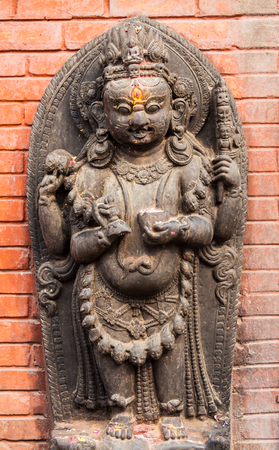 tantra: A sculpture of a Buddhist god in Svayambhunath, Nepal Stock Photo