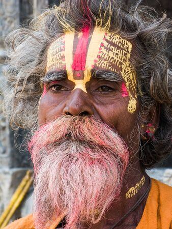 A portrait of an Indian holy man painted with sacred symbols. Editorial
