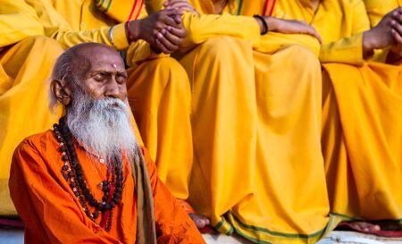 sadhu: India, Rishikesh - 15th May 2013 - Old sadhu listens to Hindu bhajans in praise of the gods - Rishikesh, India. Editorial